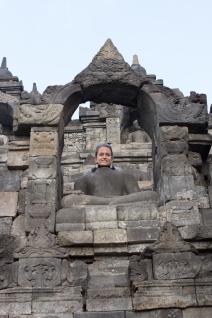 Caitlin on a buddha