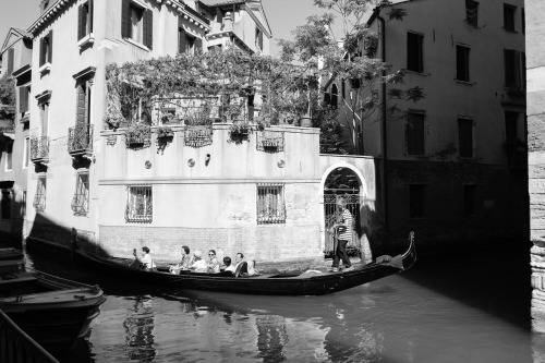 There were so many gondolas going in the middle of the day that it felt a little bit like a disney ride. I thought for sure there was a chain underneath the surface of the water to pull the boats through the same route.