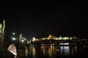 Prague and St. Charles bridge at night.