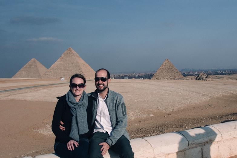 In front of all three pyramids at Giza. Can you tell which one is the tallest?