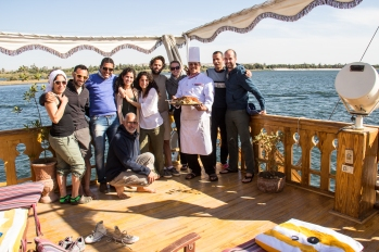 Some of the crew, guide, chef and fellow passengers. The family who we shared the boat with was amazing and made for a great travel group. The chef is holding a big plate of koshari. He was an incredible chef that made some amazing meals.