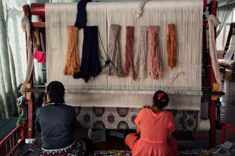 Weaving carpets.