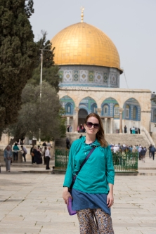 Caitlin in front of the dome of the rock in her lent hoodie.