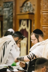 Tefillin arm wraps during the prayer process. Something I had not witnessed before.